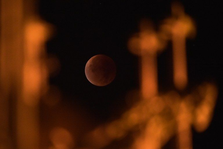 "A swollen ""supermoon"" bathed in the blood-red light of a total eclipse is seen in Strasbourg, eastern France."