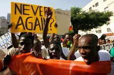 African refugees and asylum seekers shouting slogans and holding placards demonstrate as they march during a protest asking for asylum in Tel-Aviv, Friday, Nov. 2, 2007