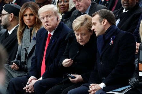 FILE: French President Emmanuel Macron, German Chancellor Angela Merkel, U.S. President Donald Trump and first lady Melania Trump attend a commemoration ceremony for Armistice Day, 100 years after the end of the First World War at the Arc de Triomphe in P