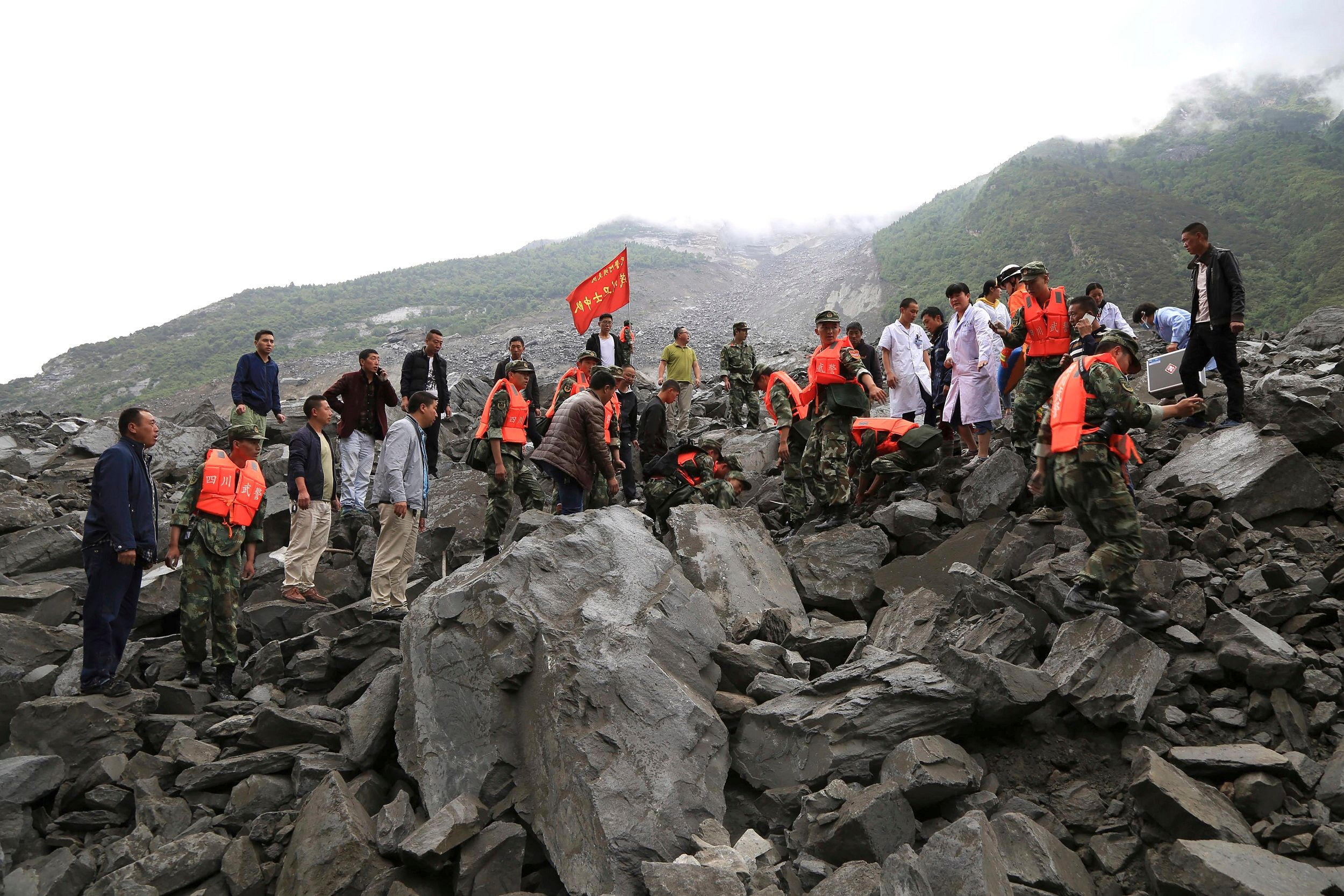 Fifteen dead, over 100 people missing in China landslide