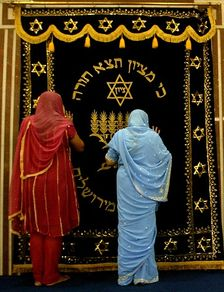 Indian Jewish women pray at the 'Hekhal', an ornamental closet which contains each synagogue's Torah scrolls, after a prayer ceremony to mark Rosh Hashanah, the Jewish New Year at the Magen Hassidin Synagogue in Mumbai, India, Thursday, Sept. 13, 2007.