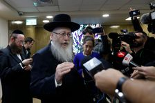 FILE: Israeli Health Minister Yaakov Litzman, who is also chairman of the ultra-Orthodox United Torah Judaism party, speaks to journalists after handing in his resignation to Israel's Prime Minister Benjamin Netanyahu, in Jerusalem, Sunday, Nov. 26, 2017.