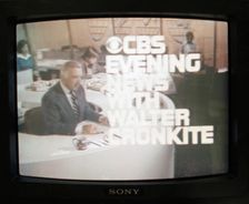 In this screen shot, Walter Cronkite is seen on the CBS evening news television broadcast from New York City, with the graphic title for the show May, 24, 1978.