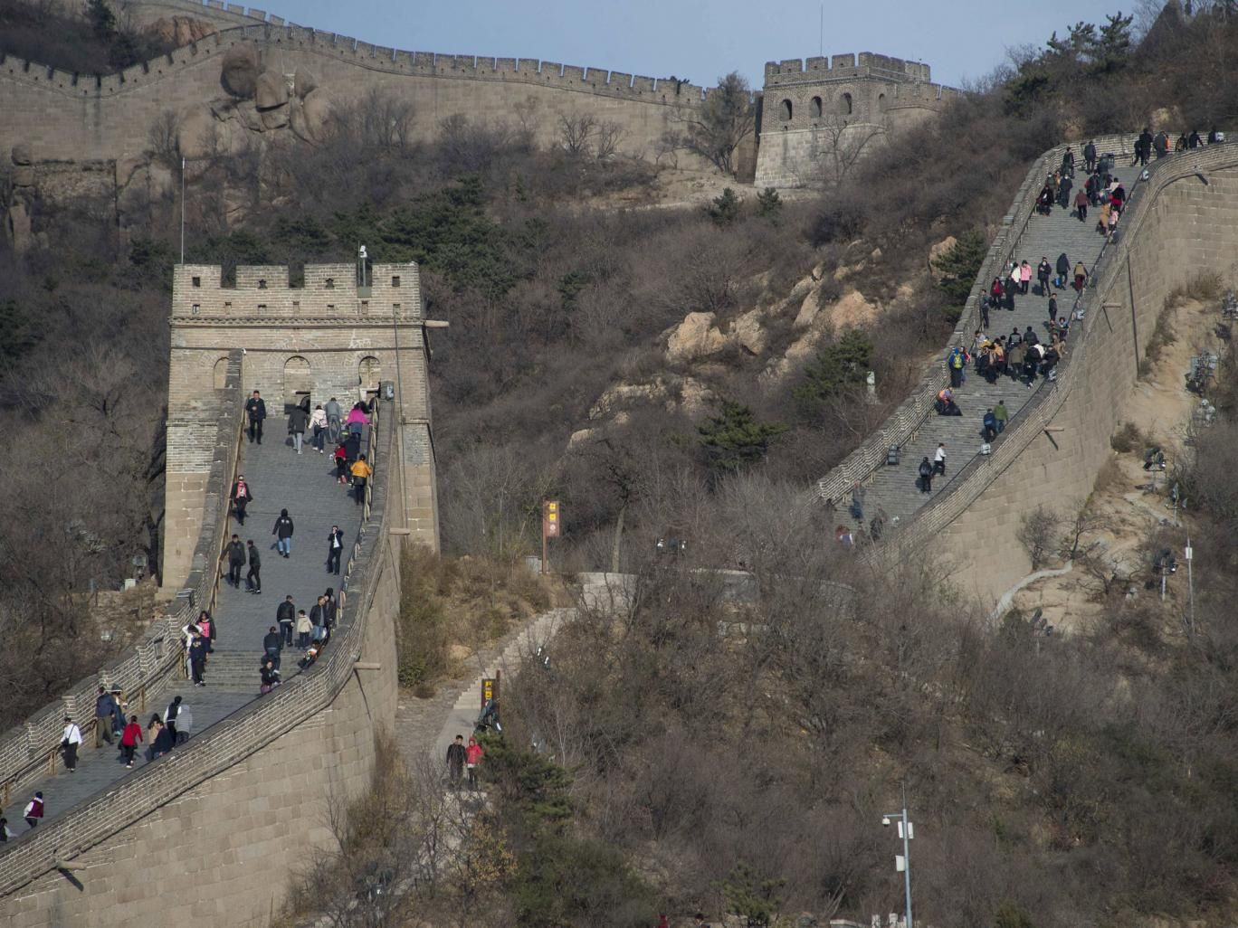 People walk along a section of the Great Wall of China at Badaling, north of Beijing, on November 11, 2014.