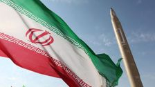A ballistic missile next to the Iranian flag (illustration)