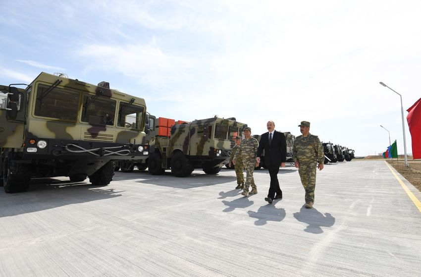Azerbaijani President Ilham Aliyev walks in front of the Israeli-made LORA artillery system at a military base on June 11 2018.