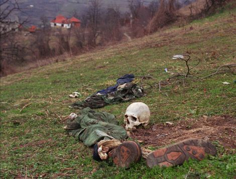 The remains of two bodies and pieces of clothing lie as they were found in a field at a suspected mass grave site near the village of Konjevic Polje, approximately 20km (12 miles) north west of Srebrenica, Tuesday, April 2, 1996.