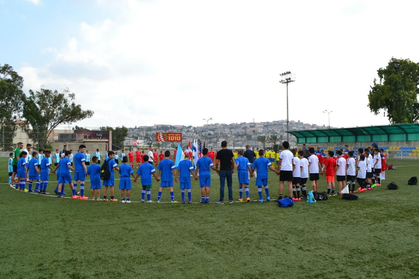 Jewish and Arab children take part in the Soccer for Peace summer camp run in conjunction with Givat Haviva