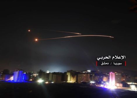 This photo provided early Thursday, May 10, 2018, by the government-controlled Syrian Central Military Media, shows missiles rise into the sky as Israeli missiles hit air defense position and other military bases, in Damascus, Syria.