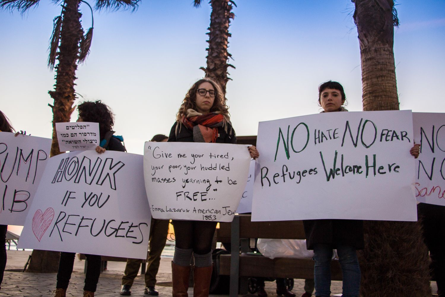 American-Israelis and African asylum seekers protest US and Israeli immigration policies at the US embassy in Tel Aviv on January 29, 2017