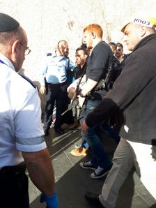 A 24 year-old Palestinian man being led away by police after stabbing a security guard outside the central bus station in Jerusalem on December 10 2017.
