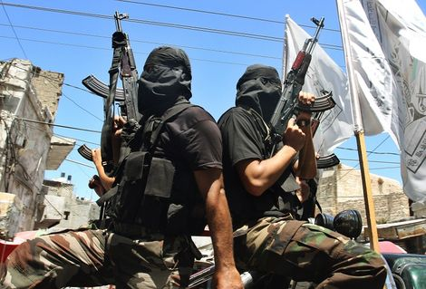 FILE: Palestinian gunmen from the Islamic group Hamas stand guard, during the funeral for five Hamas miltants killed in an explosion, in Gaza City,Saturday, July 26, 2008.