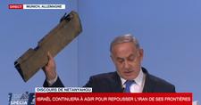 """نتنياهو ملوحا بقطعة طائرة مسيرة إيرانية: """"لا تختبروا عزم إسرائيل"""""""