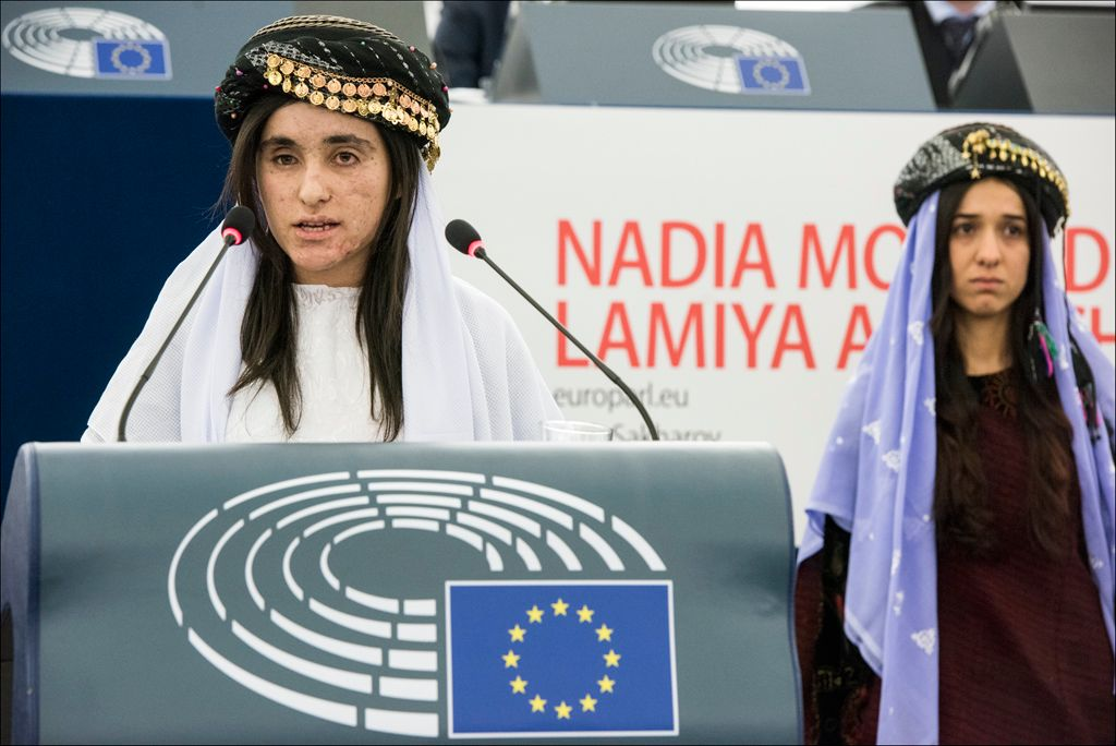 Lamia Aji Bashar (L) and Nadia Murad accept the 2016 Sakharov Prize at a ceremony in the European Parliament in Strasbourg on December 13, 2016