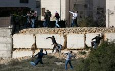 Three Palestinians injured in clashes with Israeli forces amidst ongoing manhunt
