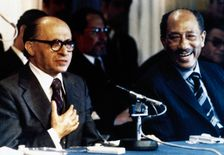 President Anwar Sadat of Egypt, right, and Israeli Prime Minister Menachem Begin smile as they address the international press November 21, 1977 in Jerusalem. It was on the third day of Sadat's history-making trip to Israel, the first Arab leader to recog