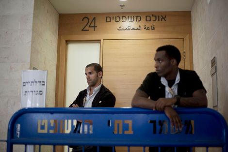 FILE- Israeli court security officers stand guard at the entrance to a courtroom in Petah Tikva, Israel, Sunday, July 6, 2014. Israeli authorities on Sunday announced the arrests of several Jewish suspects in the death of Muhammed Abu Khdeir, 16