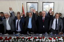 From left to right in front row, Hamas leader in the Gaza Strip Yahya Sinwar, Head of Palestinian General Intelligence Majid Faraj, Head of the Hamas political bureau Ismail Haniyeh, Palestinian Prime Minister Rami Hamdallah and an Egyptian mediator hold