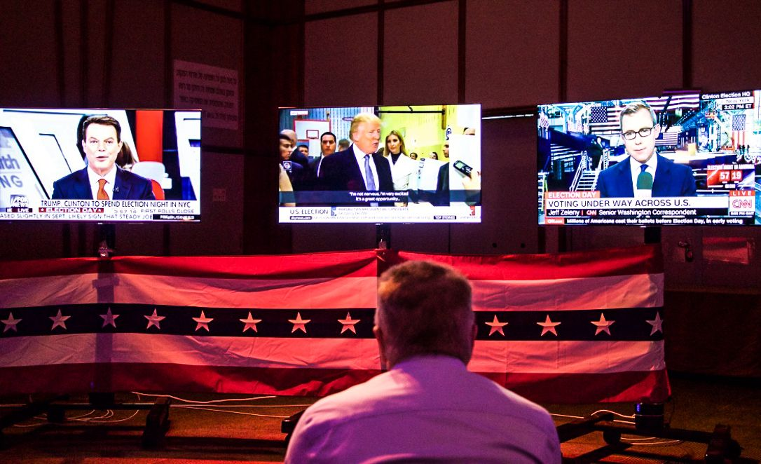 A man watches election coverage at the US embassy election party in Tel Aviv on November 8, 2016