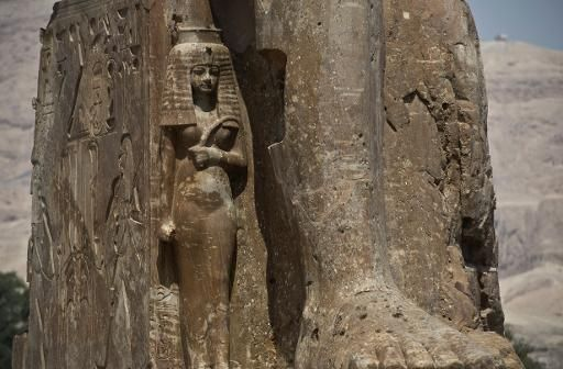 A new statue of pharaoh Amenhotep III and his wife Tiye is unveiled in Egypt's temple city of Luxor on March 23, 2014