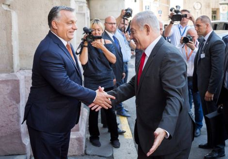 Hungarian Prime Minister Viktor Orban, left, shake hands with Israel's Prime Minister Benjamin Netanyahu prior to meeting of Netanyahu and the Visegrad Group's (V4) Prime Ministers in the Pesti Vigado building in Budapest, Hungary, Wednesday, July 19, 201