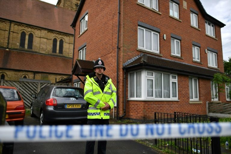 Armed police performing raid in Moss Side, Manchester