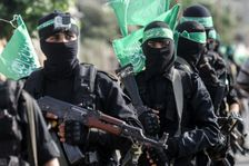 Fighters from the armed wing of Palestinian movement Hamas march in the southern Gaza city of Khan Yunis on July 20, 2017