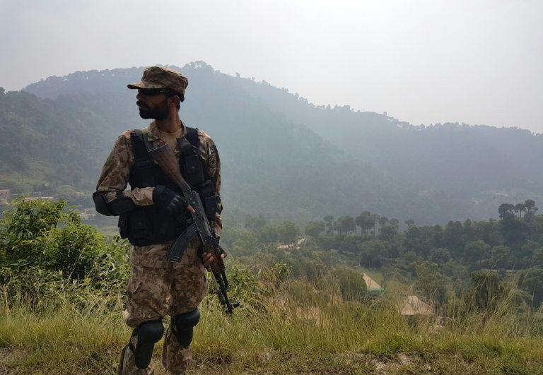 A Pakistani soldier patrols a village in Bhimber near the Line of Control in Kashmir during a media trip organised by the Pakistani army on October 1, 2016