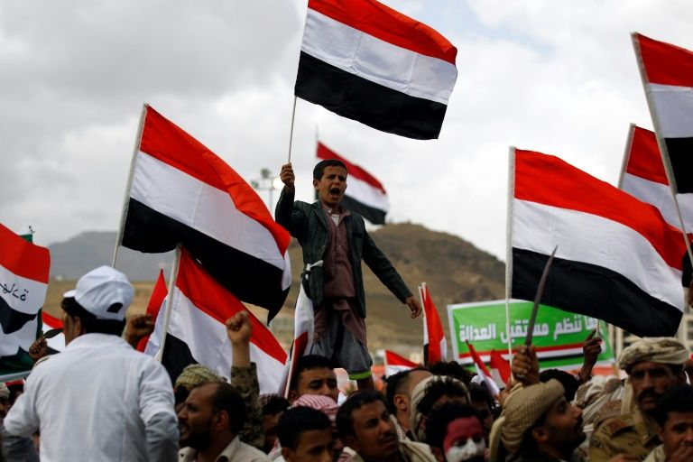 Supporters of Yemen's Huthi rebels and their allies chant slogans during a rally in Sanaa on March 26, 2017