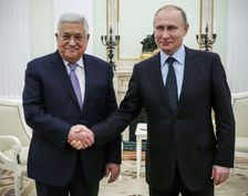 Russian President Vladimir Putin, right, shakes hands with Palestinian leader Mahmud Abbas in Moscow