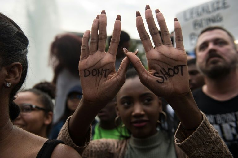 A protester demonstrates against police brutality during a rally in Charlotte, North Carolina, on September 21, 2016