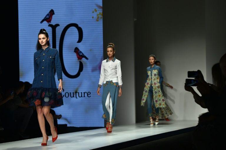 Models present creations by Saudi Arabia's Suzan Farhoud and Leen Al-Shishakly during the Arab Fashion Week on October 8, 2016 in Dubai