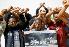 African migrants protest on February 22, 2018 outside the Saharonim Prison, where at least nine others have been incarcerated as part of Israel's policy of prison or deportation for migrants