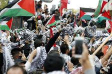 Protestors wave the Palestinian flag during a demonstration outside the US embassy in Awkar, on the outskirts of the Lebanese capital Beirut, on December 10, 2017