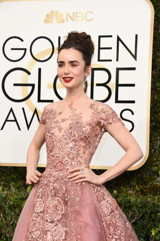 """Actress Lily Collins nominated for her work on Warren Beatty's """"Rules Don't Apply"""" -- wears a lacy sweeping Zuhair Murad gown with cap sleeves"""