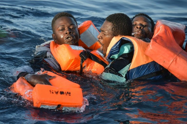 Migrants and refugees fall in the water during a rescue operation off the Libyan on November 3, 2016
