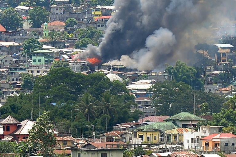 Islamic militants storm school and take hostages in the Philippines