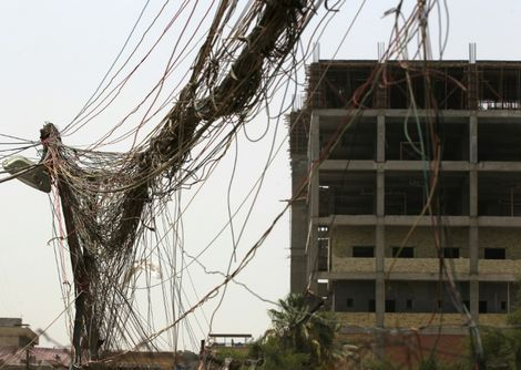 A picture taken on July 26, 2018, shows loose wires coming from a generator in Baghdad installed to supplement the poor public power grid