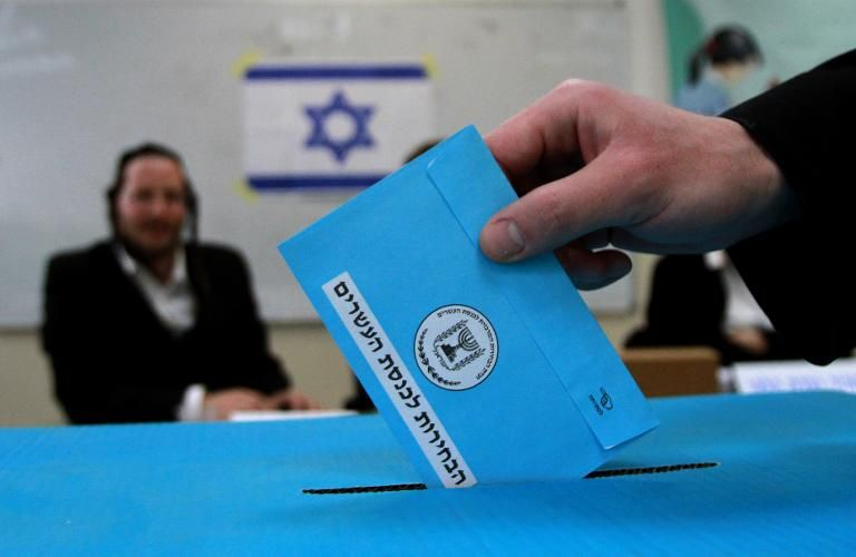 An Israeli voter casts his ballot at a polling station in Bnei Brak, near the city of Tel Aviv, on March 17, 2015