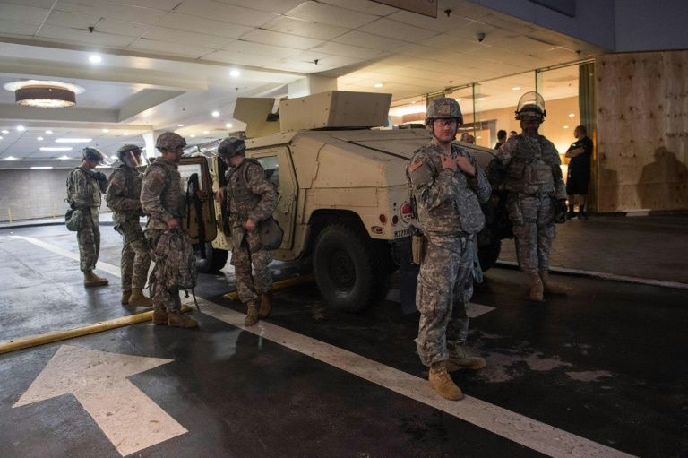 North Carolina's governor has declared a state of emergency in Charlotte, and several hundred National Guard troops were deployed to reinforce local police