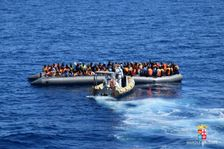This handout picture released by the Italian Navy (Marina Militare) shows a rescue operation of migrants and refugees at sea, off the coast of Sicily, on April 11, 2016