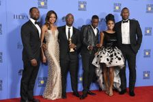 "The cast of  ""Moonlight"" pose after winning the Best Motion Picture - Drama, award at the 74th Annual Golden Globes on January 8, 2017 in Beverly Hills, California"
