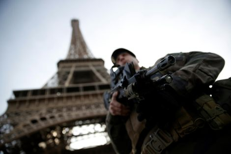 A French soldier patrols under the Eiffel Tower. The new US travel warning system rates destinations for American travelers on a four point warning scale