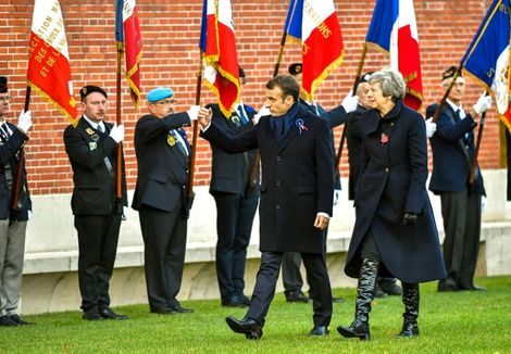 French President Emmanuel Macron (L) met Prime Minister Theresa May near the Belgian border to try to make progress on a Brexit deal and remember the fallen of the battlefields of the Somme