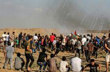 """الفلسطينيون يستعدون لـ """"مسيرات بدون عنف"""" وحشود إسرائيلية على حدود غزة"""