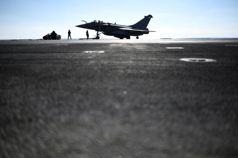 A French Rafale fighter jet prepares to take off from the deck of the Charles-de-Gaulle aircraft-carrier as part of an international coalition against the Islamic State group on December 9, 2016