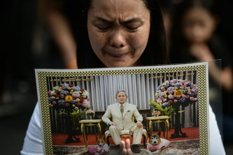 A woman pays her respects to the late Thai King Bhumibol Adulyadej outside the Grand Palace in Bangkok