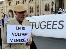 "An man protests outside the parliament building in Budapest, with a sign reading ""I was refugee also"" on September 30, 2016 ahead of Hungary's referendum on the EU's migrant resettlement plans"