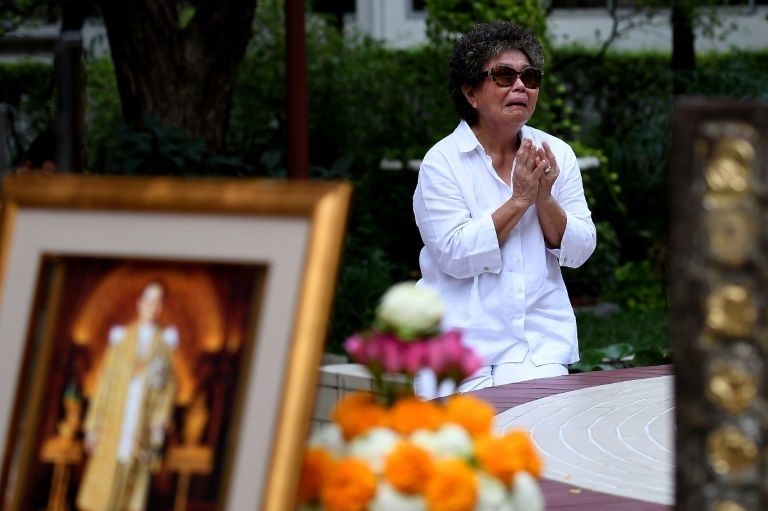 A woman mourns the death of King Bhumibol Adulyadej at the Siriraj Hospital in Bangkok, October 14, 2016.