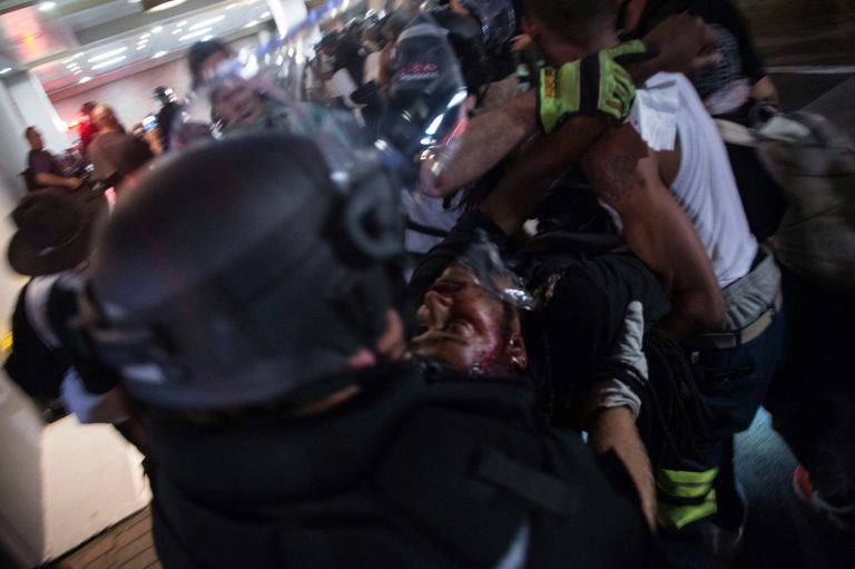 Police and protesters carry a man who was shot during a demonstration in Charlotte, North Carolina